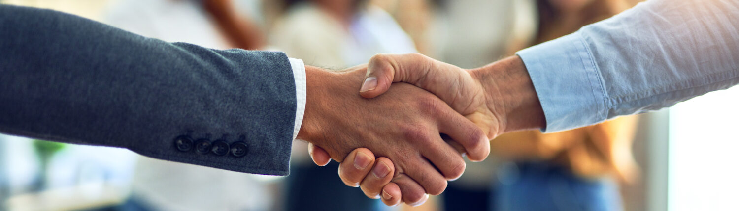 two people shaking hands to begin work on relocating a business